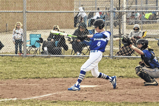 Franklin Monroe freshman Dyaln Brumbaugh takes a turn at the plate in loss to Miami East.