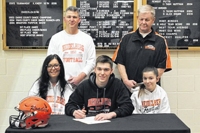 Bradford senior Larkin Painter committed Friday to play football for Heidelberg University, an NCAA Division III program in Tiffin, Ohio. (Front L-R) Sara Painter (mother), Larkin Painter, Izabella Painter (sister). (Back L-R) Jerame Painter (father), John Cruse (former Bradford head football coach).