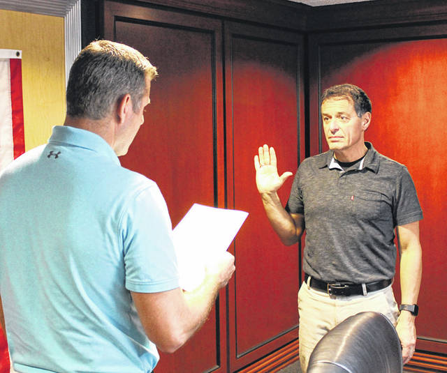 Arcanum Mayor Greg Baumle (left) administers the oath of office to Rick Genovesi (right) during Tuesday night's Arcanum Village Council meeting. Genovesi was appointed by council to fill the seat of Vanessa Delk, who resigned March 20.