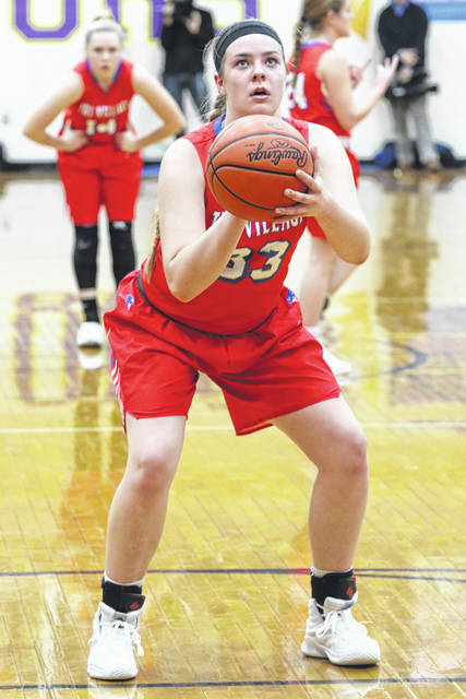 Maddie Downing hits a fourth quarter free throw for one of her 17-points to lead the Lady Patriots in scoring against Minster.