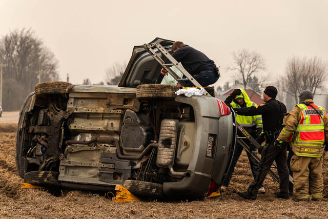 A female driver was assisted from her vehicle Saturday morning after losing control and rolling it into a field near Ansonia.
