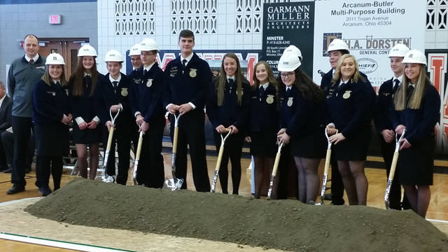 Arcanum Butler FFA members took an opportunity to shovel dirt from their new Ag Education building's construction site during a groundbreaking ceremony held Friday inside their high school gymnasium.