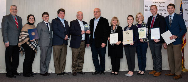 Ted Hafer, The Andersons, receives the Agricultural Achievement Award from Tony Roberts, Graves-Fearon Agency Nationwide and past Chamber chairman. Pictured (l-r) are Sam Custer, OSU Extension Darke County and Chamber Agriculture Committee chairman; Sandra Brasington, office of Gov. Mike DeWine; Josh Tovey, office of Lt. Gov. Jon Husted; Perry Walls, chairman, Darke County Chamber; Hafer; Roberts; Sharon Deschambeau, president, Darke County Chamber; Susan Manchester, Ohio representative – 84th District; Marcie Longnecker, office of Treasurer Robert Sprague; Kenny Henning, office of Secretary Frank LaRose; and Ben Thaeler, office of Rep. Warren Davidson.