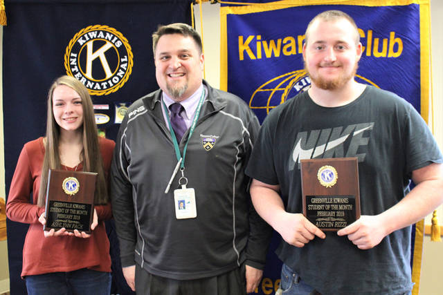 Greenville Kiwanis Club recognized Ashlynn Pack (left) and Austin Rizzi (right) as its students of the month for February 2019. They are pictured with Greenville High School Principal Stan Hughes (center).
