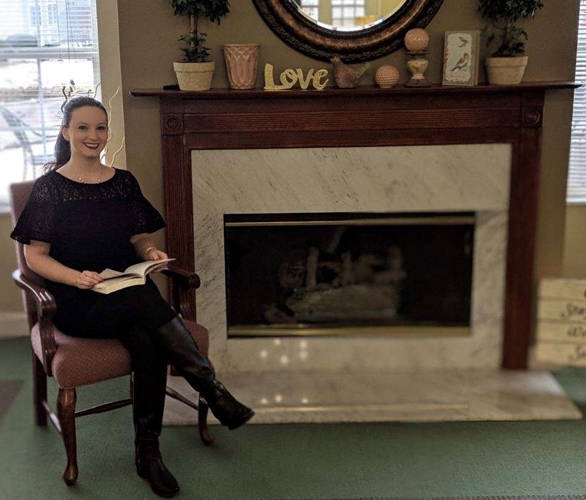 Reference Librarian Caitlyn Clark will share her love of reading with Oakley Place Assisted Living residents twice a month as a fireside reader.