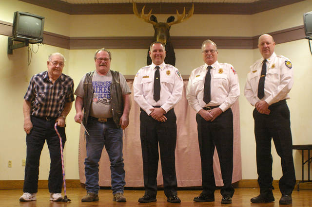 Loyal Order Of Moose Lodge No. 329 in Greenville donated $3,000 to the Darke County Fire Chiefs Association to help fund a personnel accountability system that will enhance safety and better track personnel for fire departments throughout Darke County. Pictured (l-r) are Bob Cox of the Moose, Steve Marshall of the Moose, Russ Thompson of the Greenville City Fire Department, Kurt Troutwine of the Arcanum Fire Department and Mark Loy of the Liberty Township Fire Department. The fire chiefs said they appreciate the donation, which will allow all of the county's departments to get involved in the program regardless of departments' budgetary issues. Darke County has enough funds to get started with the program but will continue to accept donations.
