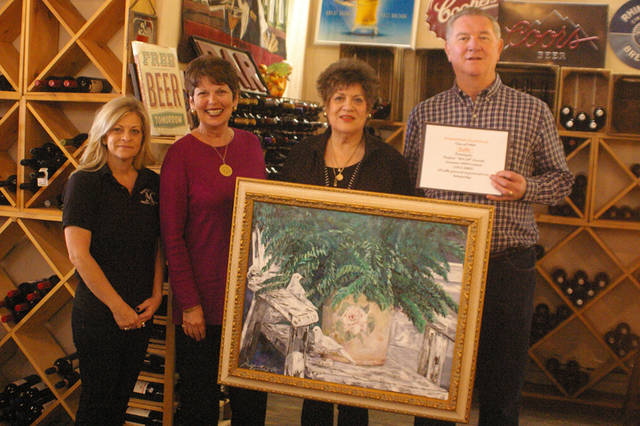 The Arcanum High School Class of 1969 will hold a raffle for a painting by Paulette (McGriff) Zawosky. Pictured (l-r) are Michele Cox, of Montage; Dianna Wagner, secretary of the Arcanum High School Class of 1969; Eva Lou Custer, donor of the painting; and Dave Gray, president of the Arcanum High School Class of 1969.