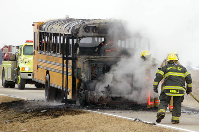 Three Franklin Monroe High School students and their bus driver were able to escape without injury when their bus caught on fire Thursday afternoon.