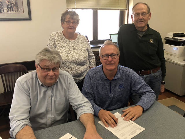 Cooper Farms finalized its asset acquisition of Hemmelgarn & Sons, Inc. Pictured are (front row, l-r) Tad Gross, Gary Cooper, (back row, l-r) Dianne Cooper and Jim Cooper.