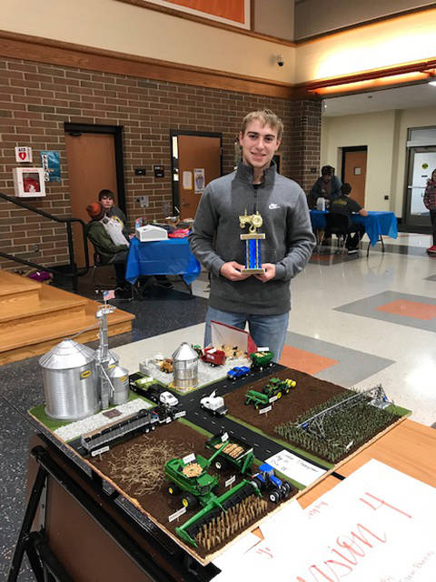 Gabe Thompson placed first in Division Four of the farm toy display competition at the Versailles FFA omelet breakfast.