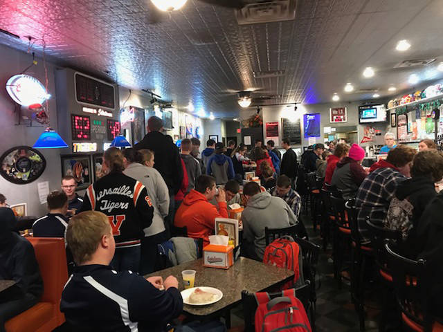More than 65 FFA Members of the Versailles FFA Chapter are shown enjoying breakfast at Sideliner's during National FFA week sponsored by Frenchtown Trailer Sales.