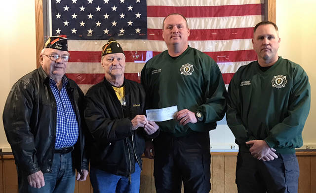 With a donation of more than $1,800 from the Greenville VFW Post 7262, the Darke County Fire Chiefs Association completed the second phase of a fundraising drive for a personnel accountability system. Plans are beginning for a third phase of the project, which will enhance safety and better track personnel for fire departments throughout Darke County. Pictured (l-r) are VFW Post 7262 Junior Vice Commander Don Dietrich, VFW Post 7262 Commander Ron Mills, Greenville Fire Department Assistant Chief Shannon Fritz and Greenville Fire Department Chief Russ Thompson.
