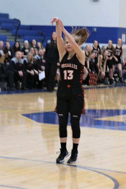 Caitlin McEldowney buries a 3-pointer for Versailles in win over Williamsburg.