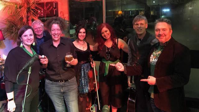 Darke County Center for the Arts' 2019 Off to the Isle winner Lorraine Grote is pictured with DCCA Artistic Director Keith Rawlins, DCCA Executive Director Andrea Jordan and Irish Wave performers Lone Raven at the recent sold out DCCA fundraising event.