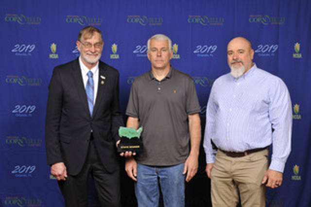 Jeff Martin of Greenville placed third in the state in the AA Non-Irrigated Class of the 2018 National Corn Yield Contest sponsored by the National Corn Growers Association. From left, Roger Zylstra, a corn grower from Lynneville, Iowa, and chairman of the NCGA Stewardship Action Team, presented the state trophy to Martin and Mike Less during the Commodity Classic, held earlier this month in Orlando, Florida.