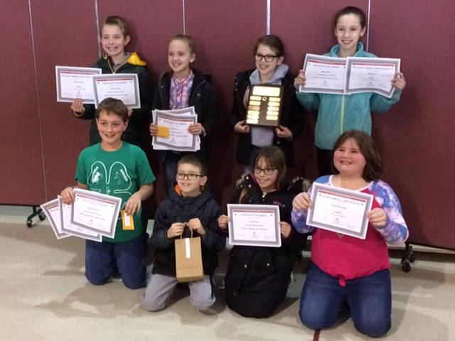 Members of Ansonia Animal with their awards included (front row) Kaeden Waymire, Luke Hahn, Charlotte Rismiller, Savannah Oswalt, (back row) Byron Young, Lydia Hahn, Elise Hahn and Miley Walls.