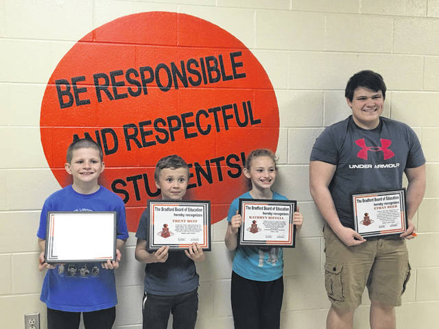From left to right, students Johnny Stewart, Trent Best, Kathryn Riffell and Ethan Reed were recognized during the Bradford Board of Education's student spotlight on Monday evening.