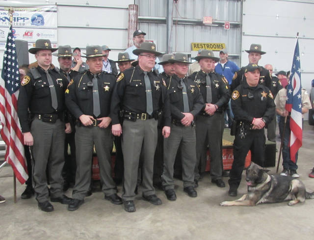 The Darke County Sheriff's Patrol held its 57th annual Home & Sports Expo this past weekend. During opening ceremonies, members were asked to assemble in front of the stage for pictures and applause.