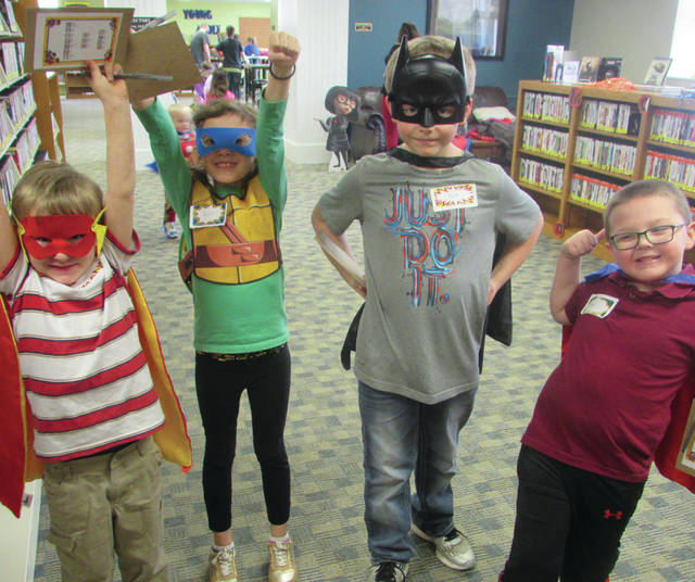 "Greenville Public Library patrons were treated to a ""Superhero Day"" on Saturday. Kids were invited to dress as their favorite superheroes while library staff dressed as supervillains."