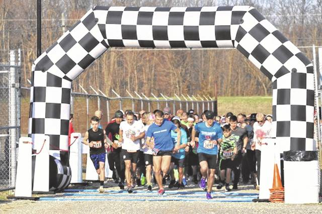 More than 300 runners leave the start line at the 6th annual Heart and Sole 5K race at Eldora Speedway.