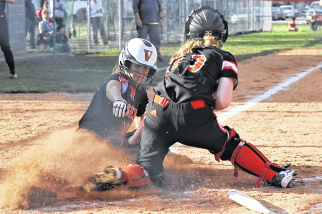 Caitlin McEldowney scores the final run for Versailles Lady Tigers in 11-1 run rule win over Ansonia.