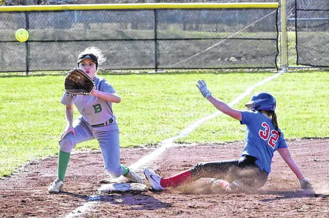 Andi Bietry slides into third for the Lady Patriots in win over the Lady Bees.