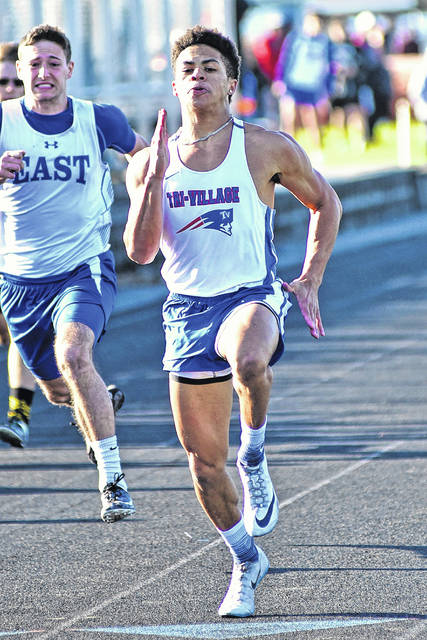 Tri-Village sprinter Austin Bruner breaks one of three records the Patriots' sprinter set at the Arcanum Invitational.