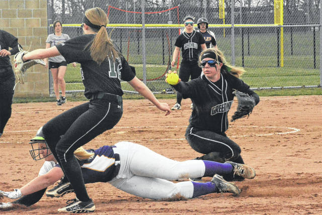 Susi Blocker makes a play for the Lady Wave at first base in team's win over Vandalia-Butler.