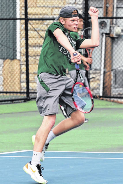 Branson Leigerber hits a shot for Greenville in his Wednesday night second singles win over Chaminade Julienne's Will Marchal.