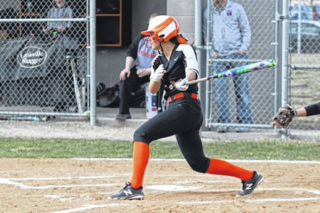Arcanum's Camille Pohl knocks one of her two hits on the day in win over Coldwater.
