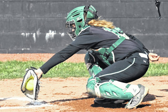 Greenville's Chloe Sowry works behind the plate for the Lady Wave softball team.