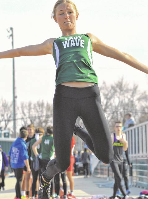 Lady Wave Emma Klosterman sets a new school record in the triple jump.