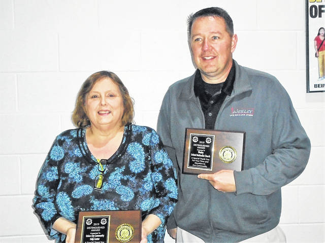 Theresa Hampshire accepted the Distinguished Service Award for Community Help Center, and Pastor Geoff Grow accepted on behalf of Wesley United Methodist Church. Merna Brenner, another winner, was unable to attend the banquet but was recognized for her work with the Preservation Society.