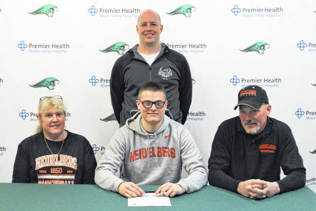 Greenville's Noah Walker signs to play basketball for Heidelberg University. L-R: Shellie Walker (mother), Walker and Chet Walker (father). Back: Greenville coach Kyle Joseph.