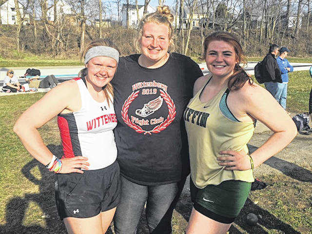 Wittenberg freshman Kathryn Combs, Wittenberg sophomore Hannah Eley and Tiffin's Nicole Berry share a moment at the recent Tiffleberg Invitational track and field event.
