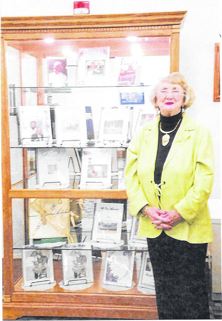 Marilyn J. Lease-Fritz stands with her display at the Greenville Public Library.