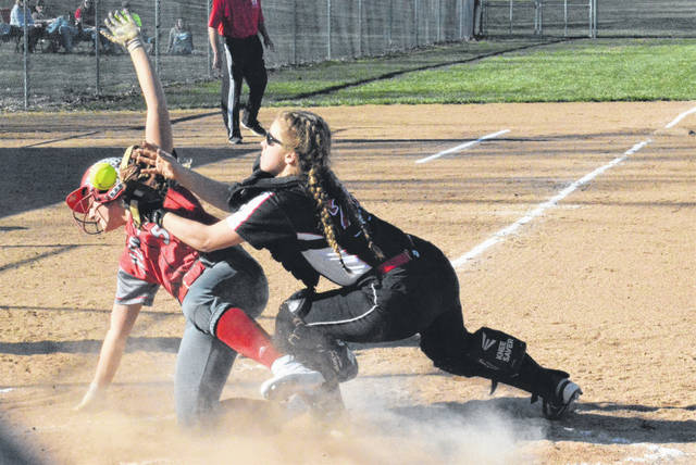 Lady Hawks catcher Madi Townsend attemps a putout at the plate against Tri-County North.