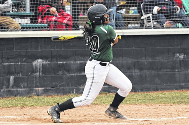 Lady Wave sophomore center fielder Nyesha Wright with a homerun swing.