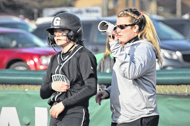 Greenville senior left fielder Lani Shilt and Lady Wave first base coach Justine Shilt talk strategy in win over Troy.