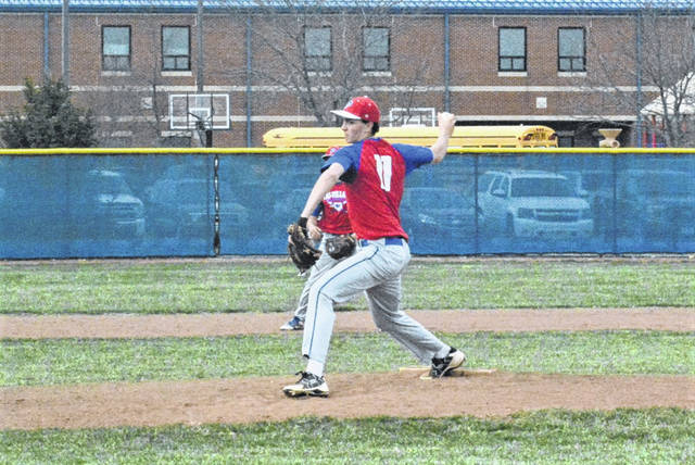 Dylan Finkbine pitches for Tri-Village in CCC game with National Trail.