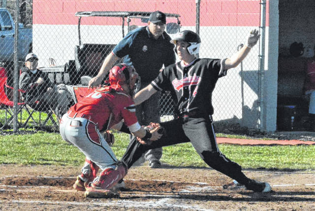 Mississinawa Valley's Trent Collins is called out in a controversial call at the plate against Tri-County North.