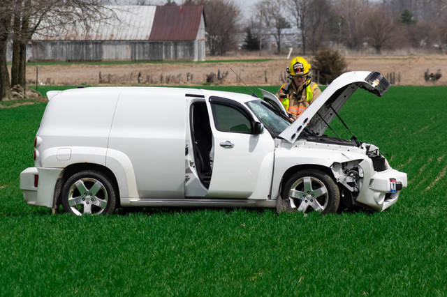 A white Chevrolet HHR went off the right side of the roadway, hitting a utility pole and downing power lines before coming to rest in a field.