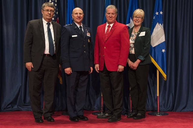 David Hills (third from left) received the 2018 Director's Award for Volunteer of the Year for his dedication and excellence in serving the National Museum of the U.S. Air Force. Pictured (l-r) are Museum Director David Tillotson III; Maj. Gen. Carl E. Schaefer, deputy commander, Air Force Materiel Command; volunteer David Hills and Air Force Museum Foundation Board of Trustees president Col. (retired) Susan E. Richardson.