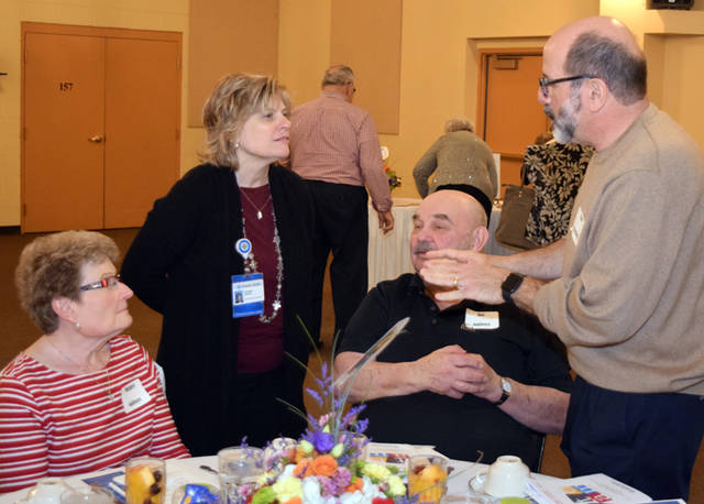 Duanna Osting, UVMC Foundation president, talks with volunteers during the annual volunteer recognition event.