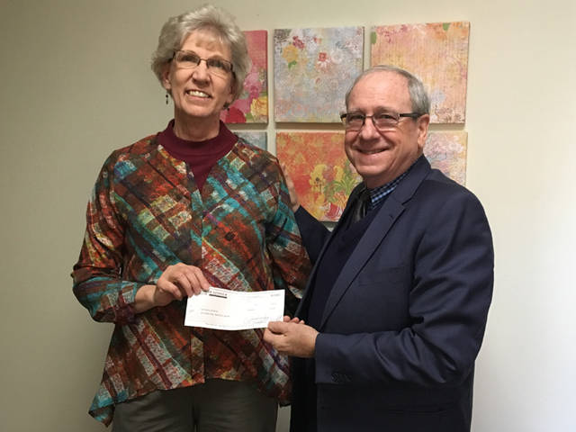Mercer Savings Bank employee Milt Miller selected Our Home Family Resource Center to receive a $200 donation as part of the bank's Mission of Giving. Miller is pictured with Kathy Mescher.