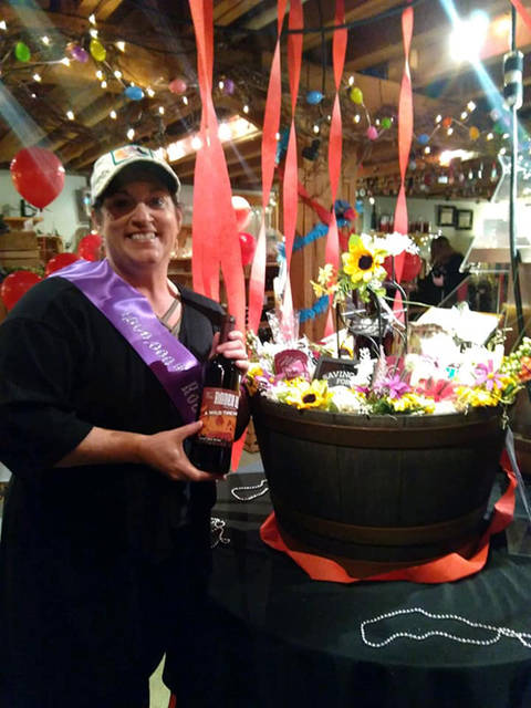 Tonya Keller of Greenville found the 1 millionth produced bottle of Rodeo Red produced by The Winery at Versailles.