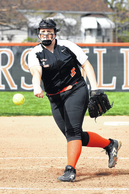 Macy Skelton toes the rubber for the Arcanum Lady Trojans in Monday night win over Versailles.