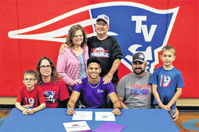 Austin Bruner and his family at the Tri-Village athletes signing to play play football and run track for Bluffton University.
