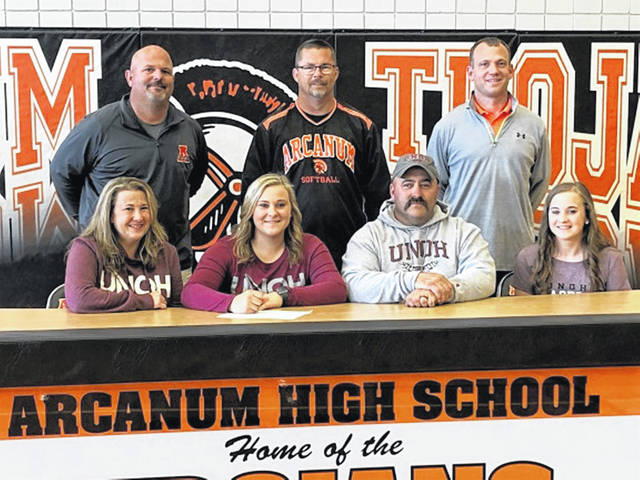 (Front L-R) Renee Wilcox (mother), Wilcox, Brad Wilcox (father) and Alexis Wilcox (sister). (Back L-R) Jason Schondelmyer (Arcanum Athletic Director), Rick Stone (Arcanum softball coach) and Jason Stephen (Arcanum HS Principal).