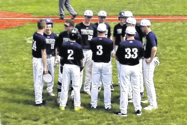 Greenville American Legion Post 140 coach Chad Henry (No. 3) talks to his players between innings of 17-2 tournament win over the Sarnia Braves.